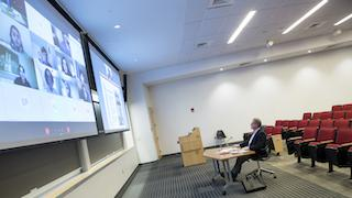 Former Rutgers President Richard McCormick teaches a remote class in Rutgers Academic Building 1170.